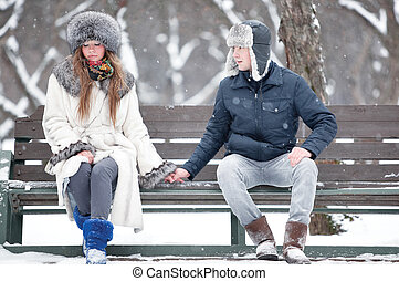 Young couple sitting on a bench