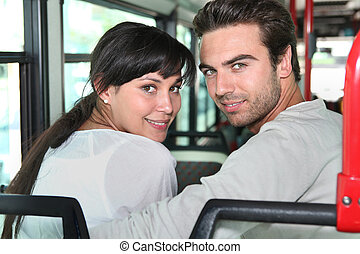 Young couple sitting on a bus