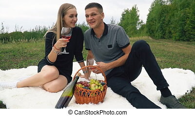 young couple sitting on lawn