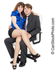 Young couple sitting on office chair