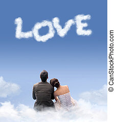 Young couple sitting on the clouds