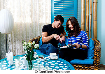 Young couple sitting on the couch in spa salon.