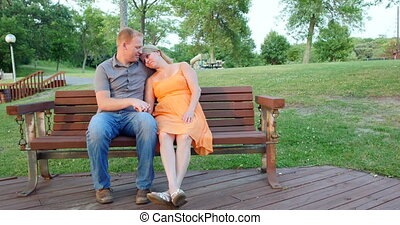 Young couple sitting together .