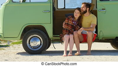 Young couple sitting van on a sunny day 4k