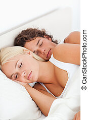 Young couple sleeping