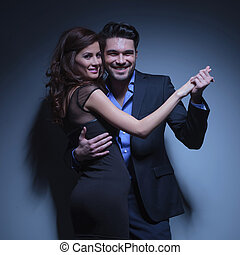 young couple smiling in dance pose