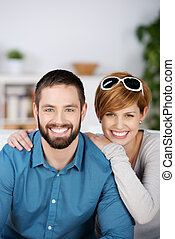 Young Couple Smiling Together In House