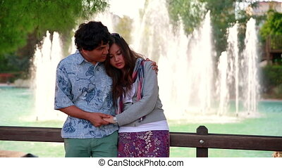 Young couple standing in front of fountain