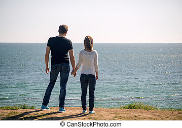 Young couple standing on a beach