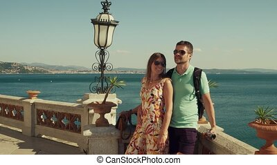 Young couple standing on the sea view terrace
