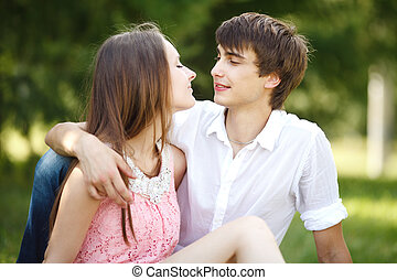 Young couple at green grass.