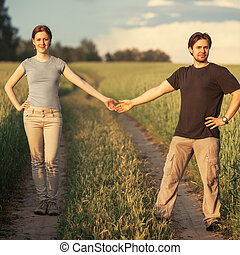 Young couple on summer field.