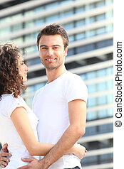 Young couple stood outside
