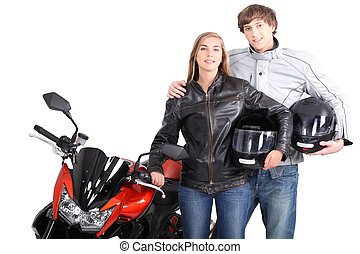 Young couple stood with motorcycle
