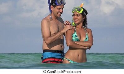 Young Couple Swimming In Ocean Vacation