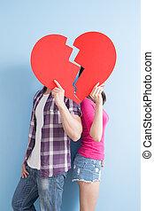 young couple take broken heart