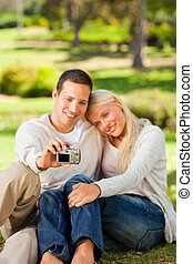 Young couple taking a photo of them