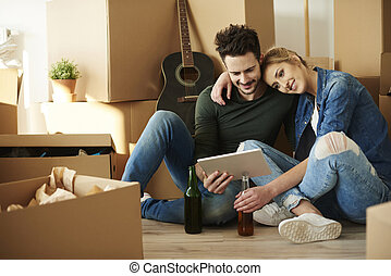 Young couple taking break from moving home