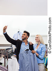 Young Couple Taking Selfie Photo Fashion Shop, Happy Smiling Man And Woman Shopping Customers