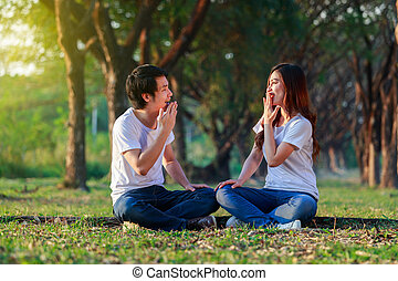 young couple talking and laghing in park