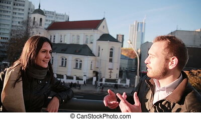 Young couple talking in city