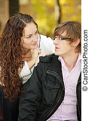 Young couple talking in park