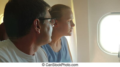 Young couple talking in the airplane