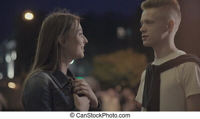 Young couple talking on the street