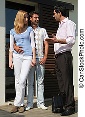 Young couple talking to a salesman