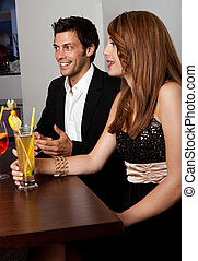 Young couple talking with friends