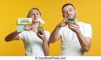 Young couple throwing out money. success, cash money, ...