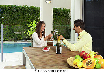 Young couple toasting with champagne