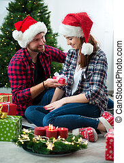 Young couple together celebrating Christmas
