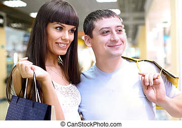 Young couple together doing shopping