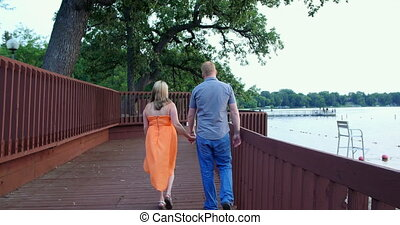 Young couple together in a park.