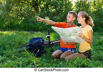 Young couple tourist read the map and show the direction