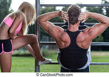 Young couple training at gym