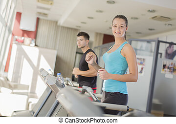 Young couple training in the gym