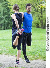 Young couple training in the park