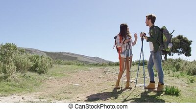 Young couple trekking in mountains - Young couple with ...