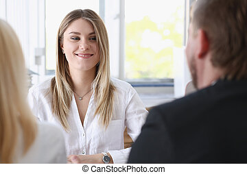Young couple trying to get loan at bank clerk