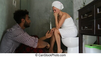 Young Couple Unhappy In Bathroom, Man And Woman Arguing Having Problem, Girl Crying Sitting On Toilet Guy On Floor