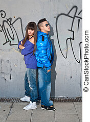Young couple urban fashion standing portrait