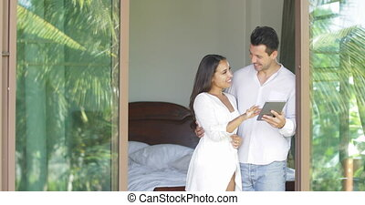 Young Couple Use Tablet Computer Looking In Window Talking...