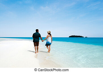 Young couple, male and female visit Aitutaki Lagoon, Cook Islands