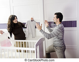 young couple waiting child