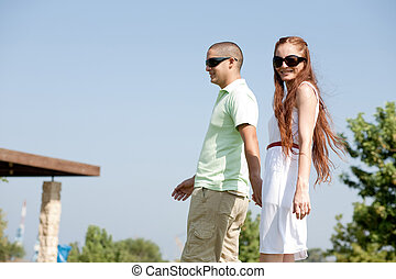 young couple walk on the park