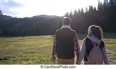 young couple walking along the lake