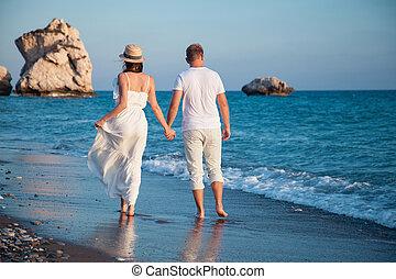 Young couple walking along the seacoast