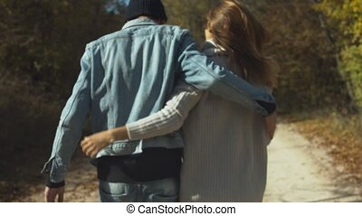 Young couple walking and holding hands